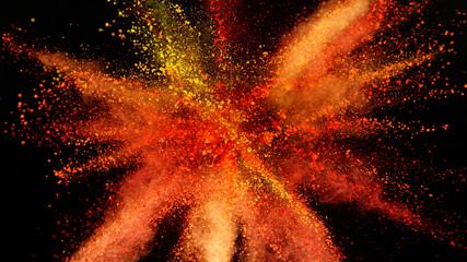 Fototapete - Explosion of orange powder isolated on black background