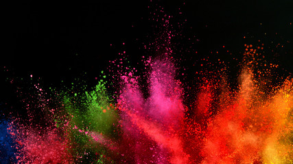 Fototapete - Explosion of colored powder isolated on black background