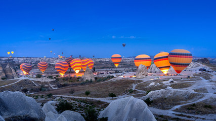 Vibrant colorful hot air balloons in Cappadocia, Turkey.