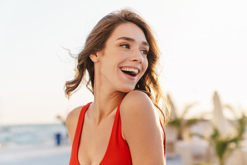 Fototapete - Photo closeup of alluring happy woman laughing and looking aside