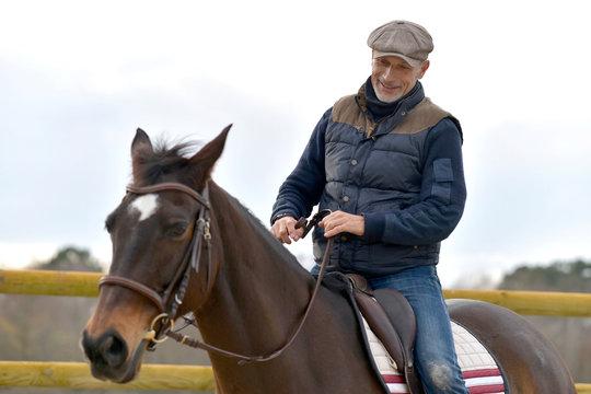 Portrait of horseman riding horse