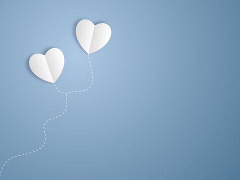 Two heart balloons in the sky
