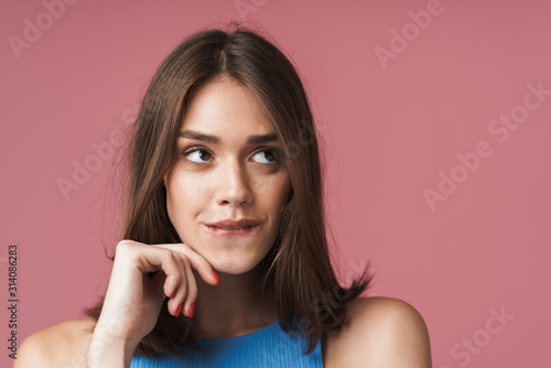 Wall mural Close up of an attractive young short brown haired woman