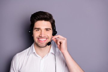 Portrait of smart confident call center worker man wear earphones can help customers clients wear formalwear clothing isolated over grey color background Fototapete