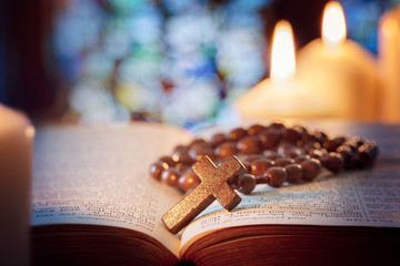 Rosary beads and crucifix cross on holy bible
