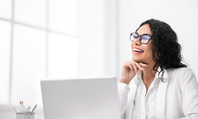 Portrait of smiling hispanic woman looking at free space