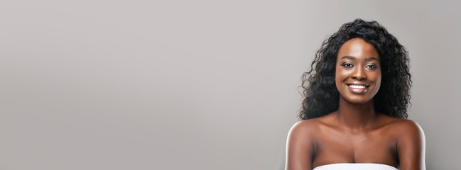 Beauty portrait of attractive afro woman with perfect skin, long banner