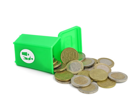 Euro coins in a green dust bin isolated on white background, concept of money wasting