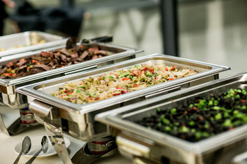 buffet food in chafing dishes at dinner event