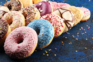 Wall Mural - assorted donuts with chocolate frosted, pink glazed and sprinkles donuts