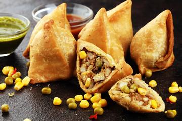 Vegetarian samsa or samosas.Indian special traditional street food fried punjabi samosa or Coxinha, Croquete and other Fried Brazilian Snacks