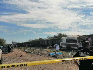General view of a bus in the aftermath of a train collision in Vicam