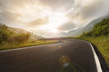 Fotorollo Beige Asphalt road in Dolomites in a summer day, Italy.