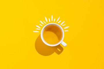 Foto op Aluminium Thee Hot drink, cup of tea with chamomile and lemon on a yellow background