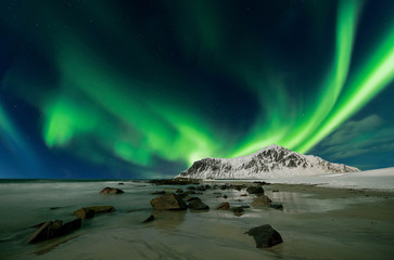 Aurora borealis also called northern lights over skagsanden beach in Norway