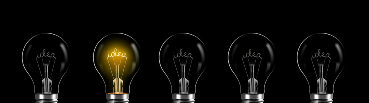 Creativity and innovation concept. idea word shining in the bulb
