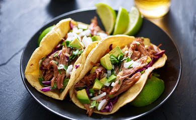 Acrylic Prints Asia Country plate of mexican carnita tacos with beer in background