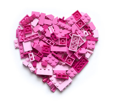 Pink heart made of blocks with white background. Love and Valentine Day concept