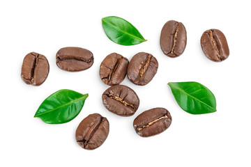 Poster Café en grains Heap of roasted coffee beans with leaves isolated on white background . Top view. Flat lay.