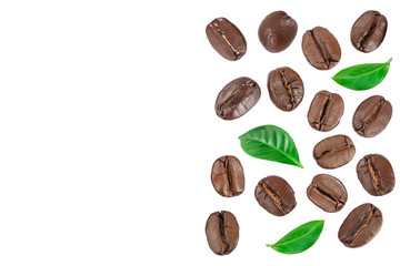 Heap of roasted coffee beans with leaves isolated on white background with copy space for your...