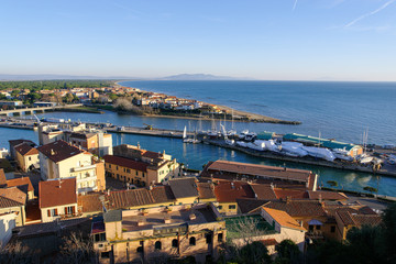 Castiglione della Pescaia, Grosseto, Tuscany, Italy, January 2, 2020 - View on the port, seascape and Argentario promontory. The city grew around a medieval fortress, it is now a tourist destination.