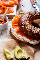 Cured salmon served  with cream  cheese, bagel, pot of  salmon caviar