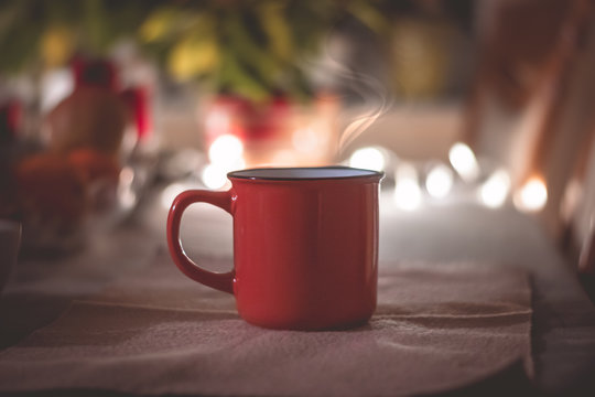 Warm christmass cup of tee, with ambient light in the background.