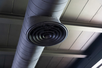 Building interior air duct and pipe. air condition system on bare skin ceiling.