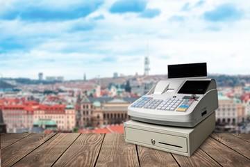 Fototapete - Cash register with LCD display on wooden desk