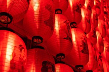 Many beautiful red lanterns with Japanese geisha patterns closeup at night
