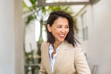 Portrait of a confident Asian businesswoman smiling. Fotomurales