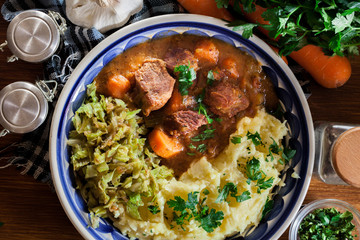 Traditional irish stew served with potatoes and cabbage