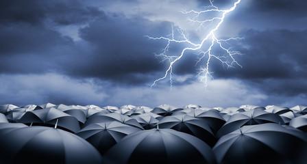Crowd of black Umbrellas in Rain and Thunderstorm wit Lightning