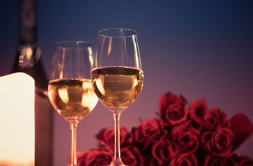 Wall Mural - Pair of wine glasses and bouquet of roses.  Dinner date night concept.