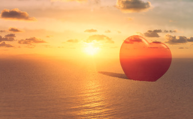 Love, tranquility and nature concept. Heart and beautiful sunset.Double exposure