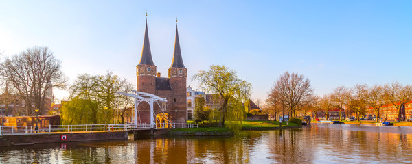 Delft, Netherlands Oostpoort or Eastern Gate domes, canal and reflection in Holland, panoramic banner Fototapete