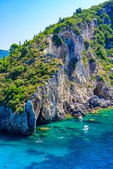 Fototapete - Agios Spiridon Beach with crystal clear azure water and white beach in beautiful landscape scenery - paradise coastline of Corfu island at Paleokastritsa, Ionian archipelago, Greece.