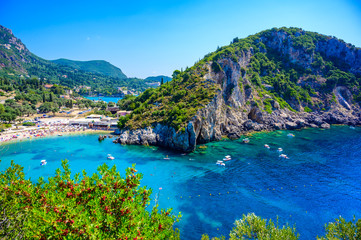 Wall Mural - Agios Spiridon Beach with crystal clear azure water and white beach in beautiful landscape scenery - paradise coastline of Corfu island at Paleokastritsa, Ionian archipelago, Greece.