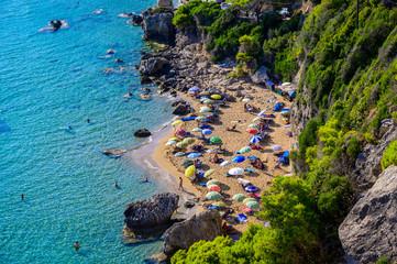Fototapete - Mirtiotissa beach with crystal clear azure water and white beach in beautiful landscape scenery - paradise coastline of Corfu island close to Glyfada Beach, Ionian archipelago, Greece.