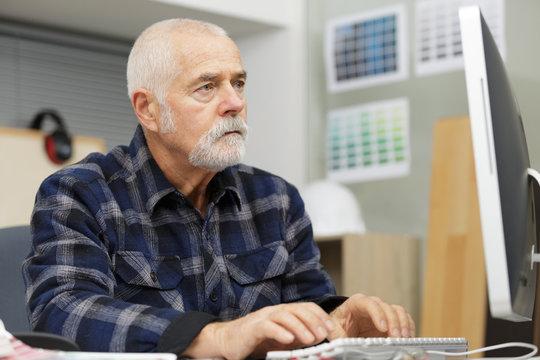 senior man using a computer