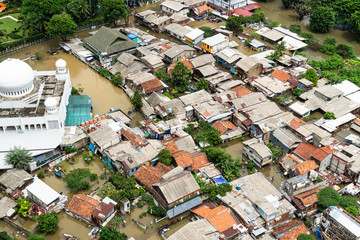 The flooded street in a poor residential district in the heart of Jakarta city in Indonesia capital city Papier Peint