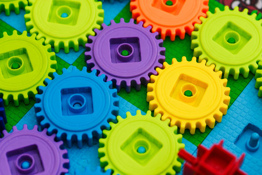 The mechanism of plastic blocks. Round multi-colored plastic blocks of the designer. Development and education