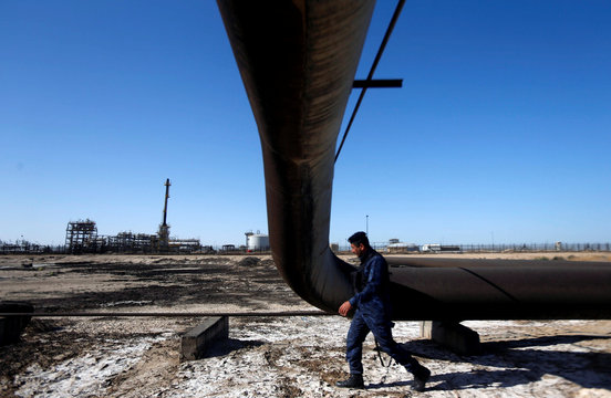 A policeman walks at West Qurna-1 oil field, which is operated by ExxonMobil, in Basra