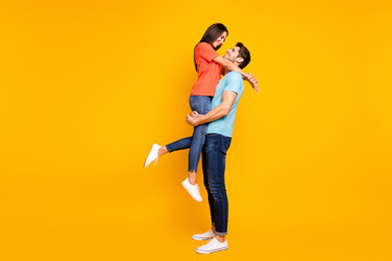 Poster Dance School Full body photo of two cute people couple guy holding carrying lady look eyes lovely weekend romance moment wear casual blue orange t-shirts jeans isolated yellow color background