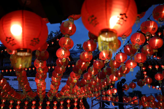 A worker checks lightbulbs in Chinese lanterns ahead of Chinese Lunar New Year celebrations on January 25 at a temple in Kuala Lumpur