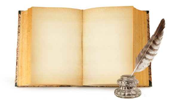 Isolated old book with copy space. Glass ink bottle and quill and one open book with empty yellow pages standing vertically isolated on white background with clipping path