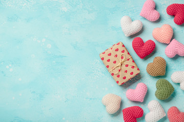 Valentine's Day background with colorful hearts and gift box