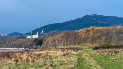Coastal track to Dunrobin Castle with autumn colours in the trees and Ben Bhraggie in the background.