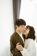 Closeup portrait of young asian couple smiling with happy together on white background. Love and valentine concept.