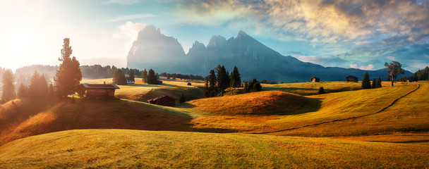 Fotobehang Alpen Wonderful Landscape with colorful sky. Seiser Alm (Alpe di Siusi) with Langkofel mountain at sunrise, Italy. Dolomites, Trentino Alto Adige, South Tyrol, Italy, Europe. Popular travel destination